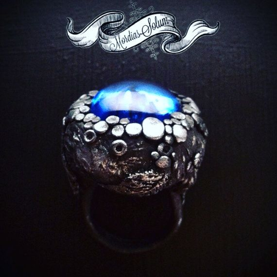 Carved Witch Ring With Blue Glass Pebble. by MordiasSolum on Etsy