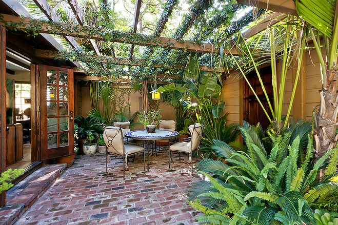Hollywood Hills bungalow for sale...Spanish style and lots of lushness...
