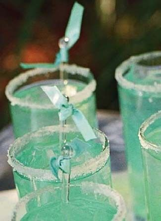 Tiffany Cocktails.    Its a Lowcountry Lemonade adding a drop of blue curacao to the peach Schnapps and lemonade and lining the rims with sugar. Instead of adding a flower to each, we will tie a tiny piece of Tiffany blue ribbon to a clear plastic swizzle stick and placed it into each glass. Nice wedding drink