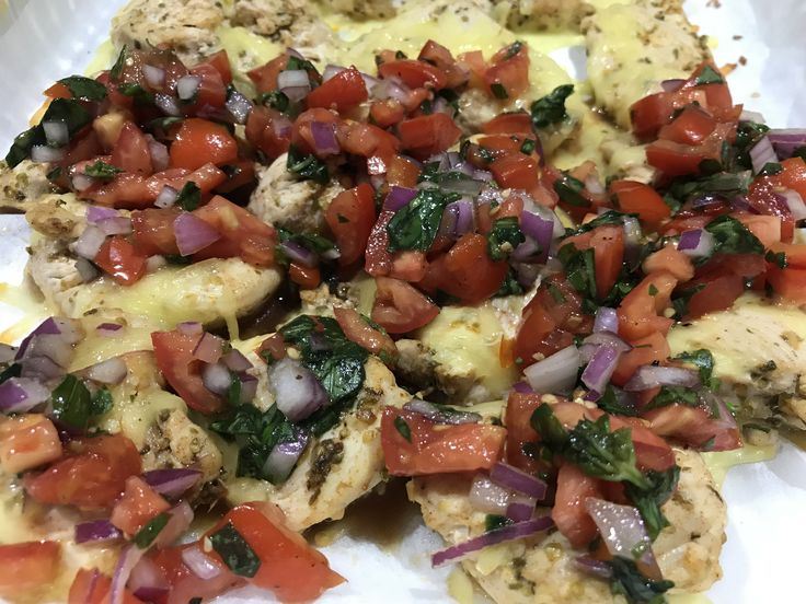 Grilled Chicken Mozzarella with bruschetta topping  As per recipe chicken breast fillets, garlic, dried oregano, paprika and olive oil with cheese topped with gourmet tomorrow's, onion and a minute touch of red wine vinegar for that pungent spite  Food glorious food