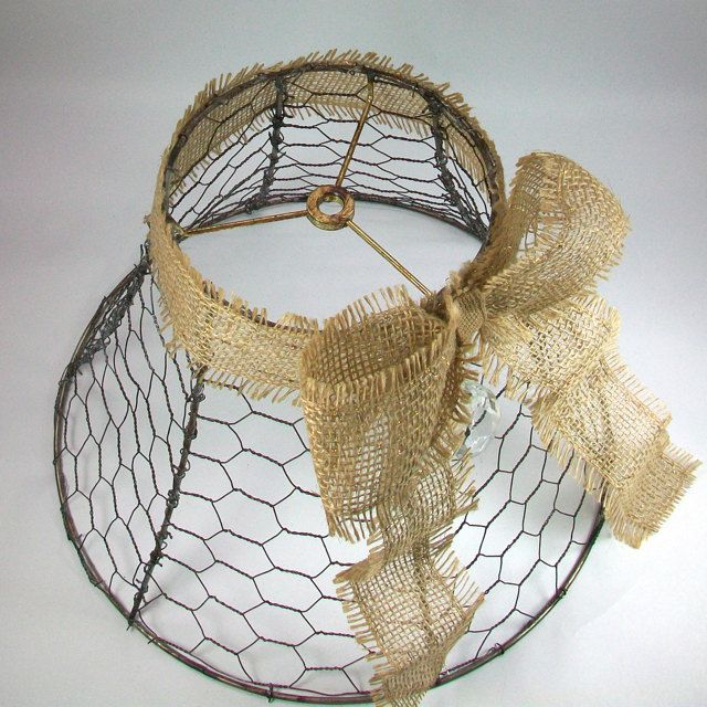 I made this from a vintage lamp shade frame. I added chicken wire, a burlap bow and an antique tear drop crystal. The chicken wire has been antiqued to give it a rustic look. The burlap bow has bits of metallic gold thread running through it, Im not sure it is noticeable in the photo.  The top of the shade is 6 across, the bottom is 13 across and it is 9 tall. The crystal is 2 long.  Thanks for stopping by OldRedHenVintage, feel free to convo me with any questions.