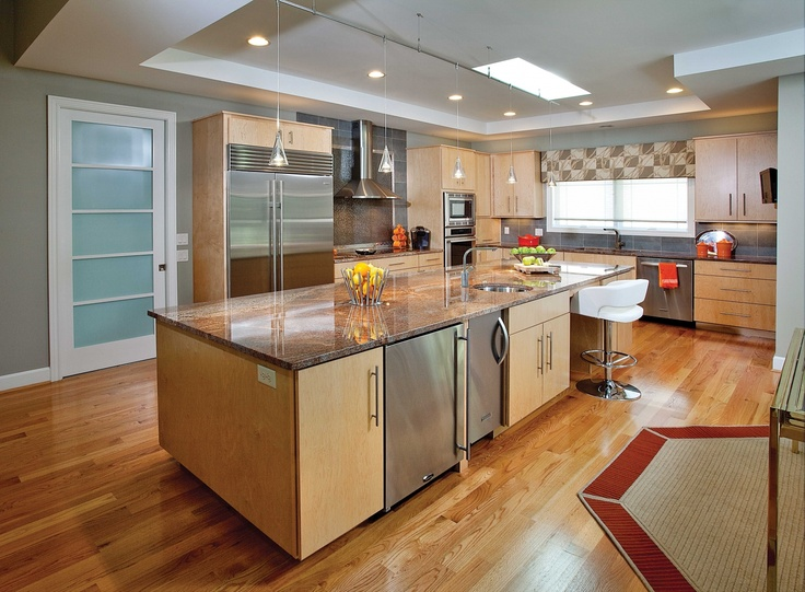 Light Oak Floors And Cabinets Bring Warmth To Room