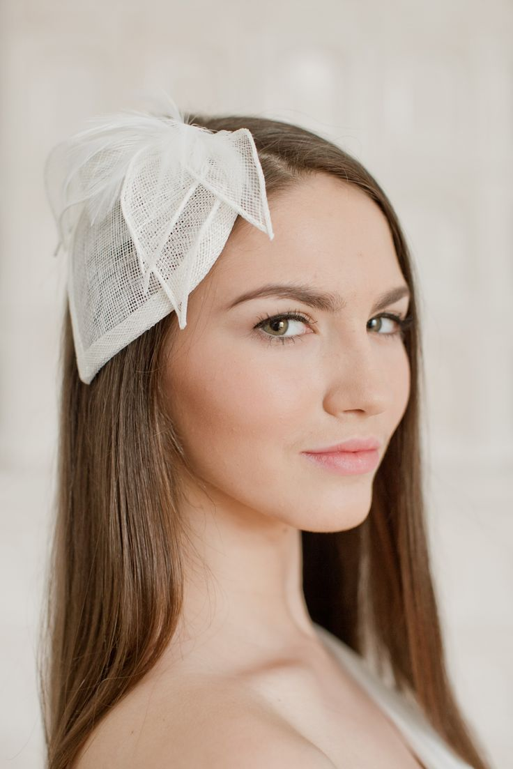 The bridal hat is completely hand made - I have blocked layers of sinamay, wired and trimmed it with feathers and sinamay petals made of the same material.   The hat attaches to hair with hair comb. It can be easily placed to any hairstyle.   Matching birdcage is also available.