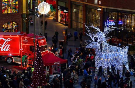 Christmas lights in Liverpool. Shoppers pass the Christmas lights and the Coca-Cola truck at Liverpool 1 in Liverpool City Centre. Issue dat...