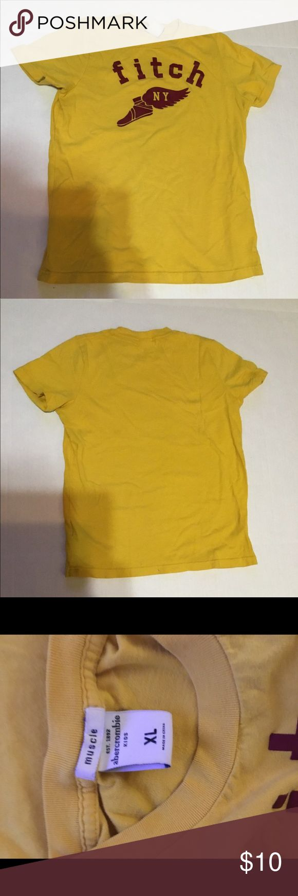 Abercrombie Kids winged foot muscle t shirt sz XL Abercrombie Kids winged foot muscle t shirt sz XL.  Older tee, still nice!  Gold and burgundy.  No rips or stains.  Great graphic! abercrombie kids Shirts & Tops Tees - Short Sleeve