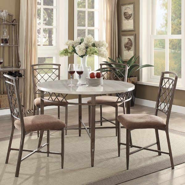 The Aldric collection features a casual dining faux marble top table with antique black metal. The chairs have fabric cushion seating with a metal base. The baker's rack provides more space to storage the dining hardware's. This collection will bolden out any dining room area with a casual style.