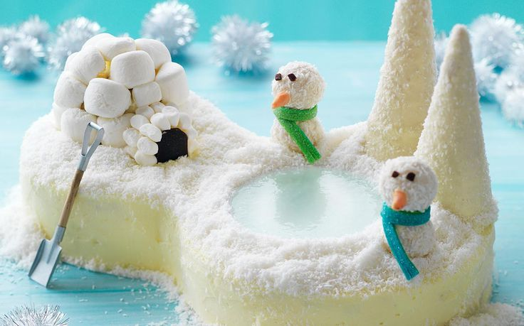 This Winter wonderland birthday cake has a frozen jelly lake and covered in coconut snow!