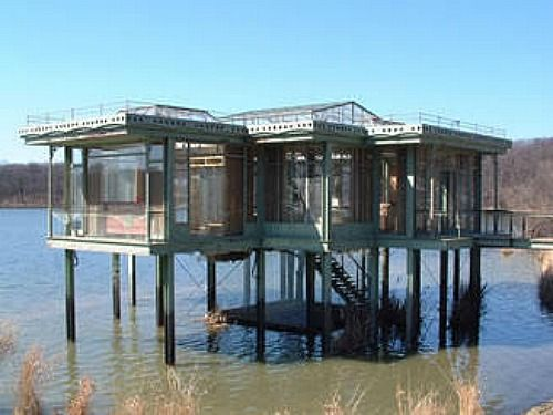 The house was actually constructed on dry land next to the lake, atop steel beams that rose 10 feet above the waterline, which was created by excavating nearly 1200 cubic feet of soil and letting lake waters flood in under the pilings.