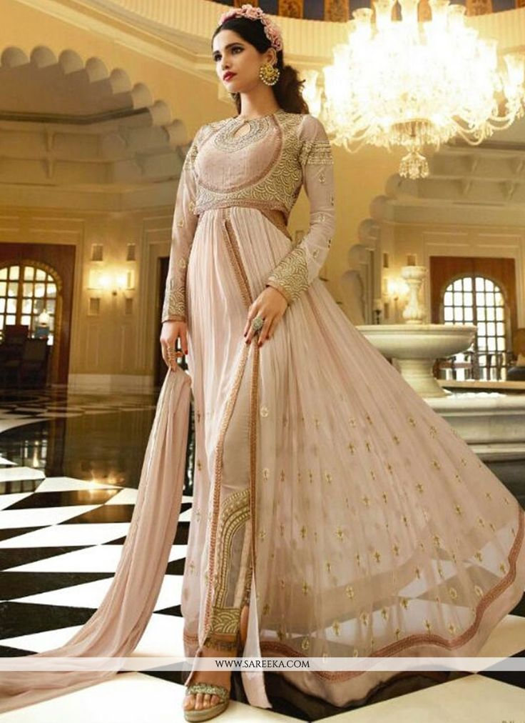 Look ethnic in this sort of a affluent beige georgette designer floor length suit. The gorgeous embroidered and lace work a vital attribute of this dress. Comes with matching bottom and dupatta. (Slig...