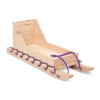 Qamutiik: Saila's sled is a smaller version of the one her family pulls behind their snowmobile when travelling to their camp in the winter. Includes a harness for Nukilik. Made of Canadian hemlock.
