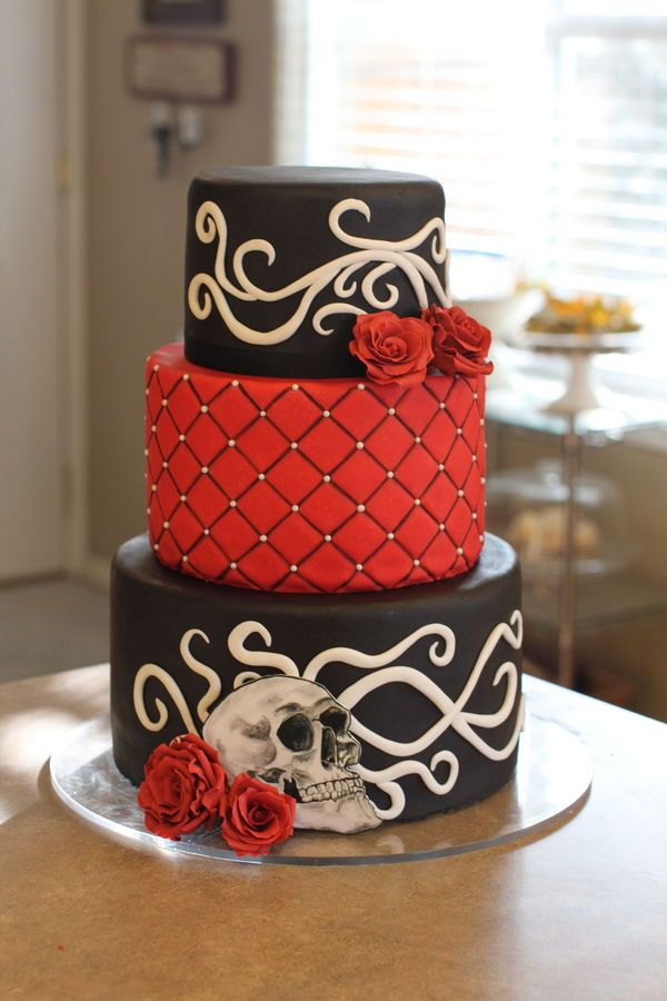 Gothic rockabilly wedding cake with sugar roses, filigree and a hand painted skull, by Sweet and Swanky Cakes