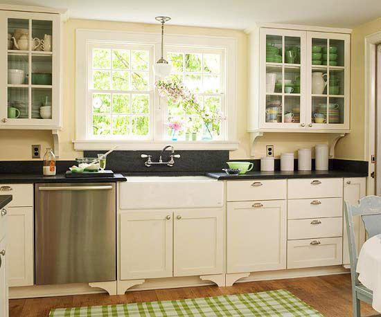 We enjoy the bright fresh light coming in through the 2 wide windows above the sink, the old-fashioned look of the pulls and fixtures, and the green accent color seen through the cabinet doors.