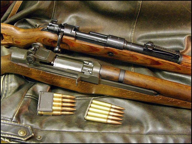 WW2 US M1 Garand & German Mauser. Note the M1 was a semi-automatic rifle firing a 8-round clip, while the bolt action Mauser only had a 5-round stripper clip. Advantage goes to the Allies...