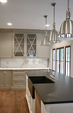 Gettysburg Gray by Benjamin Moore is by far my favorite kitchen cabinet color right now. In fact, this is probably what I will be going with in the next few months when I repaint my cabinets: