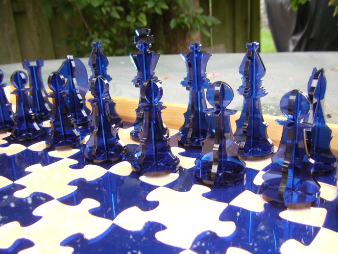 This is a quik derivative of the Plywood chess set by ohammersmith: thingiverse.com/thing:855. What's changed? I've added all pieces to one file for easy cutting, also I've created a board that fits the unique laser cut feel of the chess game.