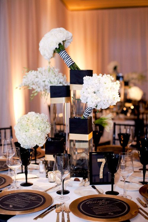 Creative bouquet display for glamorous black, white and gold wedding planned by Intertwined Events, photo by APictureLife Photography | junebugweddings.com