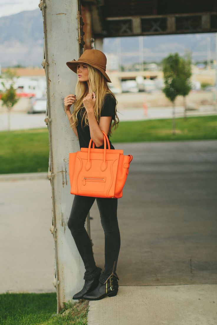 brown hat, casual outfit, with bright orange purse