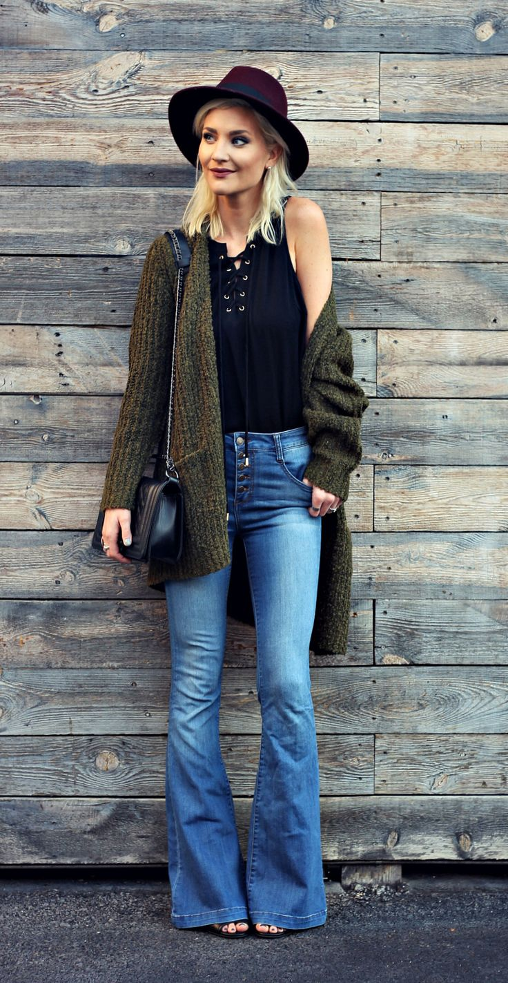 casual outfit inspo with flared jeans, lace up top and slouchy cardigan sweater, fall style