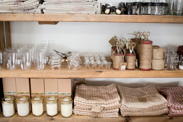 Lots of treasures! Hand blown glass, hand poured candles from Nelson BC, lint-free 100% cotton tea towels and tea towels from Caravan, spools of jute...  Photography by Sachin Khona
