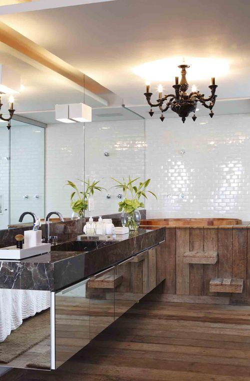 Higienopolis apartment #bathroom #interiors by architect Marcelo Rosenbaum / combination of marble, tile, wood, mirrored; modern rustic