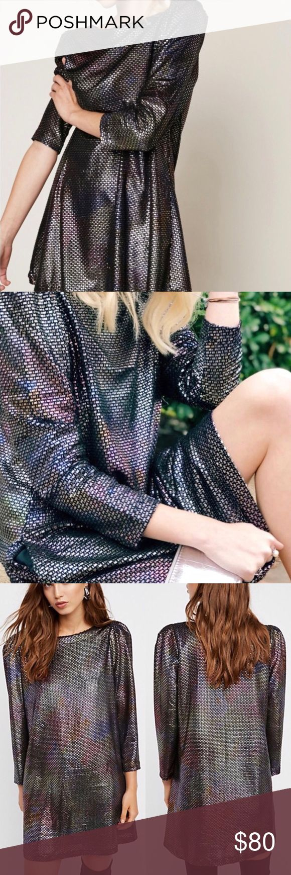 """NWT Free People Diamonds Are Forever Dress Silver NWT. Size Medium. Silver color with a """"mermaid"""" rainbow iridescent look. Long sleeve metallic mini dress featuring structured shoulders and a swingy silhouette. Side pockets. Still being sold on the Free People website.   • Make me an offer! • Free People Dresses Long Sleeve"""