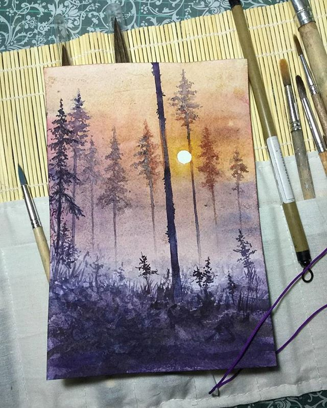 Watercolor sunset painting through the trees.