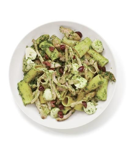 Toss shredded roasted chicken with rigatoni, pesto, olives, and mozzarella for a quick and delicious pasta salad.