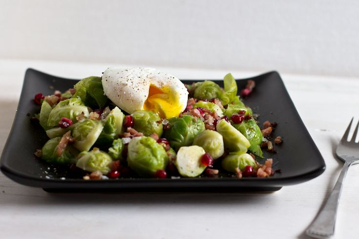 Brussel sprout with pomegranate, bacon and poached egg