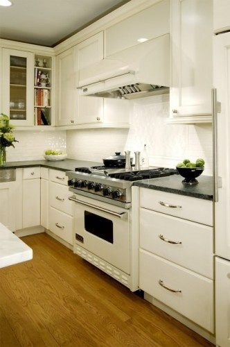 kinda loving the white oven via: The Salvage Collection