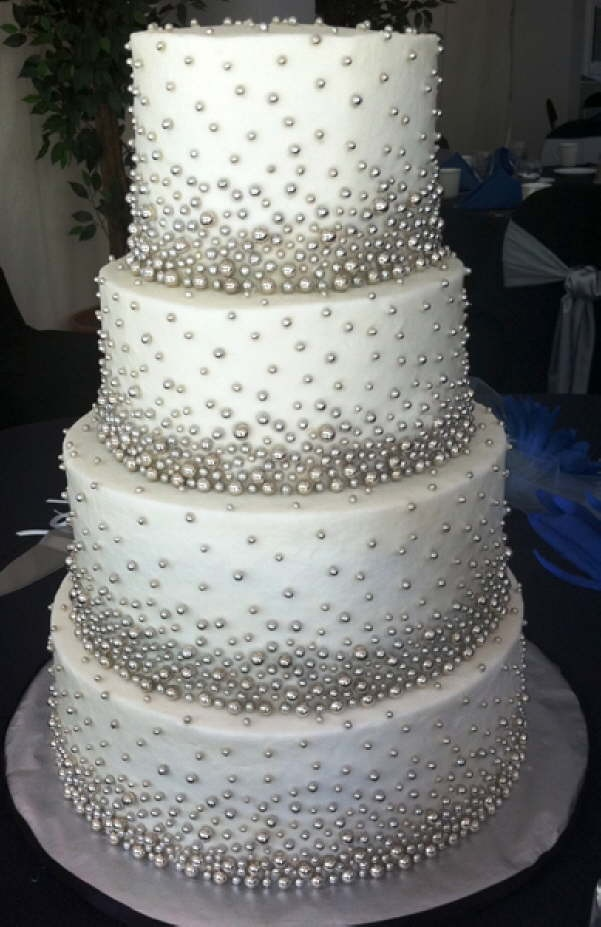 GORGEOUS white wedding cake with silver candy beading!