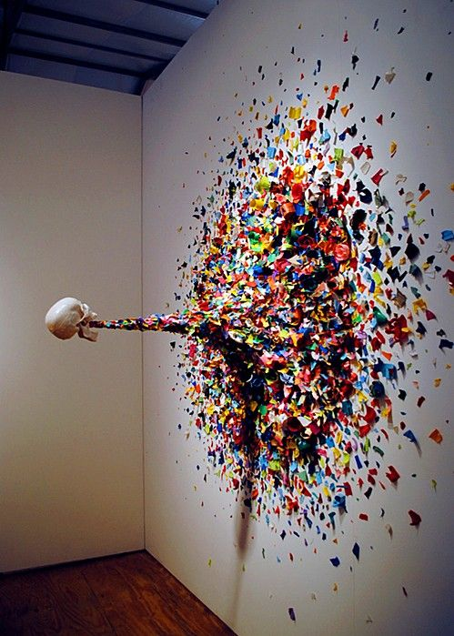 Great 3d Sculpture idea. Possibly a ceramic head connected to the wall with a metal rod and covered with painted tissue paper