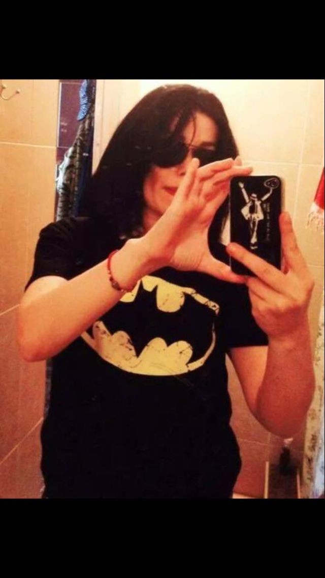MJ WEARING A BATMAN SHIRT AND HAVING HIS OWM PHONE CASE MY LIFE IS COMPLETE