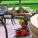 Patio Design #1016.  Paver patio with radial block steps to yard, retaining wall perfect for seating, grill station and non-tumbled pavers.