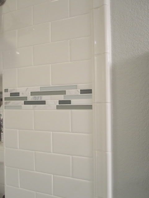 White subway tiles: Daltile from Home Depot Accent tiles: a mix of honed carrara marble, polished Calcutta marble, & aqua/grey sea-glasss from Bedrosian's, Denver location (10.50$/sq ft sheet). Wall color: Benjamin Moore Gray Owl color matched in Sherwin Williams Harmony No VOC paint