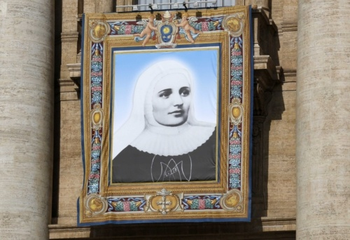 Tapestry of Mother Laura Montoya hangs on St. Peters Basilica during canonization Mass at Vatican  The tapestry of St. Laura Montoya, the Colombian founder of the Congregation of the Missionary Sisters of Mary Immaculate and of St. Catherine of Siena, hangs on St. Peters Basilica during her canonization Mass at the Vatican May 12. (CNS photo/Stefano Rellandini, Reuters)
