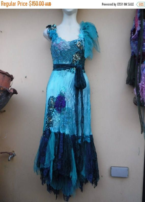 shes a wonderful romantic fantasy bohemian satin fairy gypsy dress that holds hours of artistic time and love...my price on etsy is a gift as these sell for hundreds more in galleries and boutiques which i supply from time to time.... based on a blue lace dress she has been kissed with