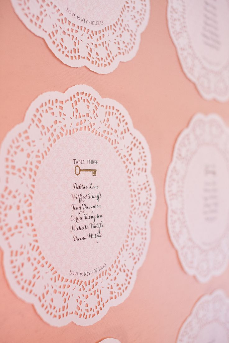 Seating Chart -- Printed on Doilies. See more of the wedding on SMP: http://www.StyleMePretty.com/canada-weddings/2014/02/20/key-themed-wedding-at-hotel-eldorado/ Kevin Trowbridge Photography