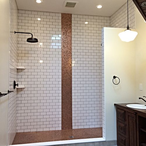 MAYBE A PENNY COUNTERTOP WITH A PENNY ACCENT ON WHITE TILE?  I LIKE.