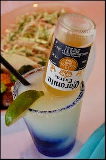 Corona-Ritas:  In a pitcher, combine equal parts of  frozen limeade concentrate, water, Sprite, tequila and then add one Corona
