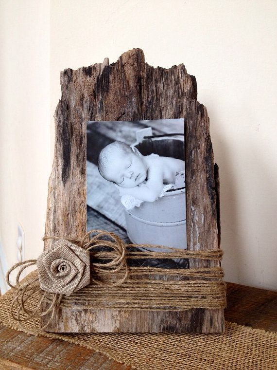 Like this could easily use drift wood - may look to recess picture  put it behind glass for 'longevity' - could also add colour to string and flower as  alternative