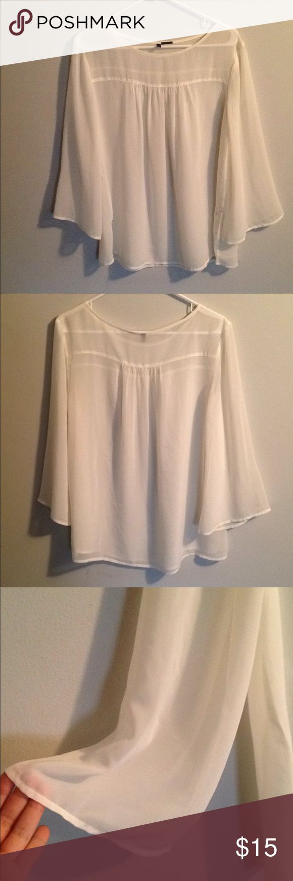 United Colors of Benetton Blouse United Colors of Benetton white sheer blouse with belled sleeves. Worn once, in great condition! Beautiful dressed up or down-- very versatile! The sleeves make it fun and unique! United Colors Of Benetton Tops