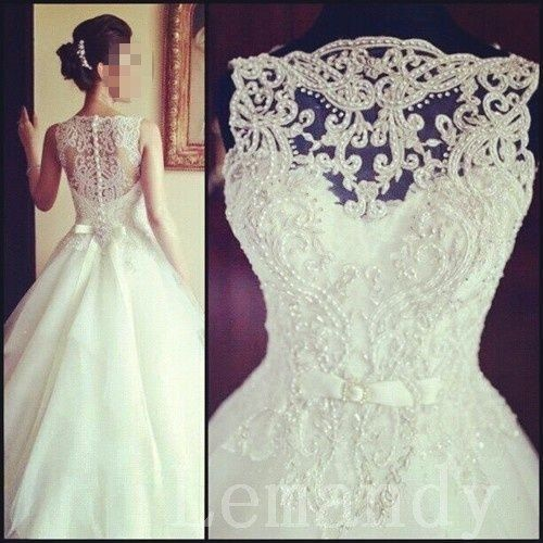Vintage sleeveless princess beaded lace and tulle wedding dress. That top looks gorgeous. $286.00, via Etsy.