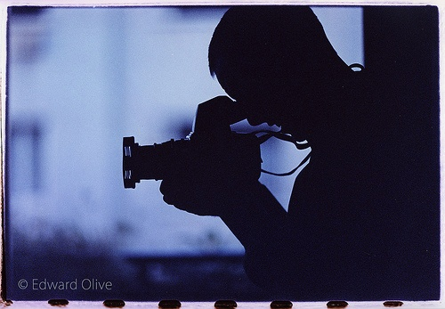 Edward Olive in blue with Hasselblad camera at dusk in daylight studio in Madrid Spain