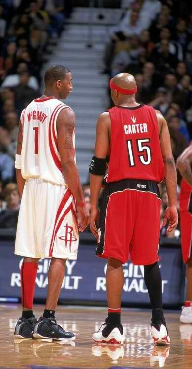Tracy McGrady and Vince Carter in different uniforms