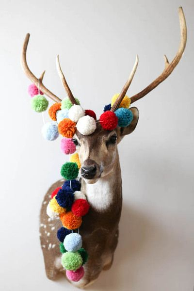 pompom garland- I never wanted a dead animal hanging on my wall... until now...