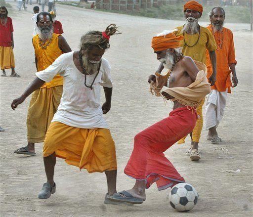 Sadhus playing soccer. Anyone at any age can play the beautiful game.