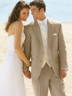Tan suits and tuxes look so amazing for Spring, Summer and Destination weddings.