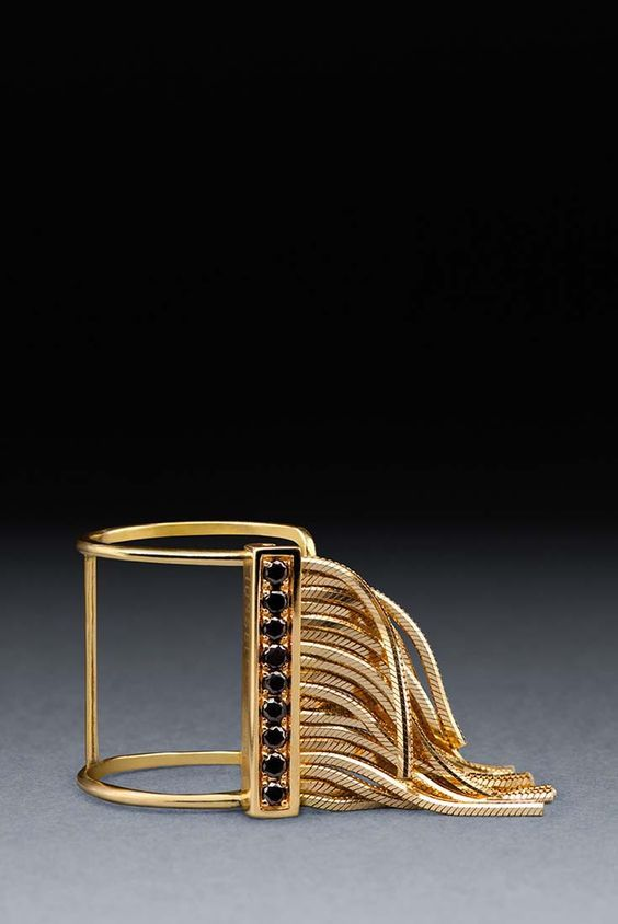18 Gold tall ring. 18k gold cut-out tall ring with fringe, 21k black diamonds.