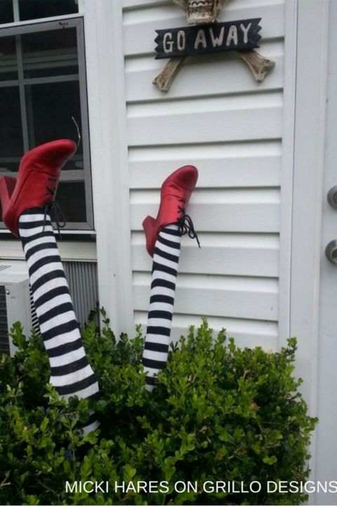 Wicked Witch Legs: Ding dong, the trick-or-treaters are here! Click through to find more easy and spooky DIY party decorations for Halloween.