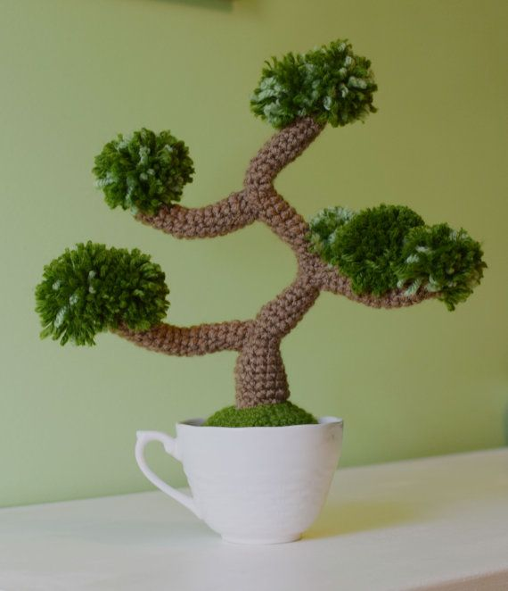 This beautiful one of a kind crochet bonsai is sure to brighten any room. It requires no watering and no sunlight. The tree is nestled in a lovely